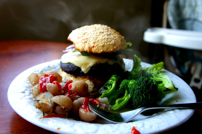 Portabello Mushroom Burgers with homemade buns, broccoli, and potatoes from the garden. ;)